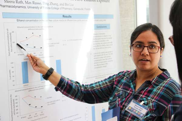 Meera Rath presents a poster at the 32nd Annual Research Showcase